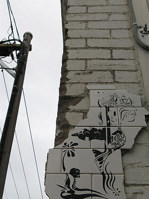 Street art in Melbourne - Ceramic street art on the corner of a brick building in Fitzroy, 2008