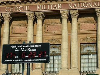 "Constitution of Romania - A sign in front of Cercul Militar Naţional counts down to the ""complete professionalization"" of the Romanian military, that is, the end of conscription (May 2006)."