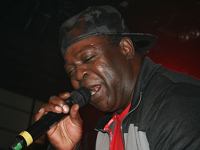 Chaka Demus, a famous reggae DJ and singer during concert.
