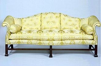 Thomas Affleck - Marlborough-leg camel-back sofa (c. 1775 – 1800), attributed to Affleck, Diplomatic Reception Rooms, U.S. Department of State.
