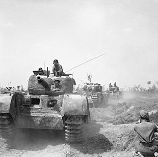 Churchill tanks being filmed by an AFPU cameraman during the advance of 56th Division north-east of Argenta, Italy, 17 April 1945. NA24288.jpg