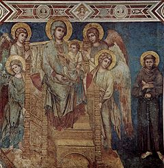 A Gothic fresco showing, to the right, a carved throne on which sits the Virgin Mary with the Christ Child. Around the throne are four angels. To the left stands St Francis in a brown robe, looking small and humble. The colour of the background and robes is predominantly sky blue, but the ancient surface has flaked to show brown underpainting. The faces are gentle and realistic.