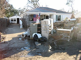 Reconstruction of New Orleans - Clearing out trashed possessions and gutting flood damaged home, Gentilly neighborhood, January 2006.