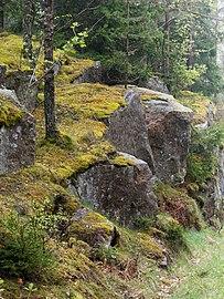 Cliffs by a misty road in Holma.jpg