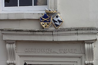 Escutcheon (heraldry) - Male (shield-shaped) and female (lozenge-shaped) coats of arms in relief in Southwark, London.