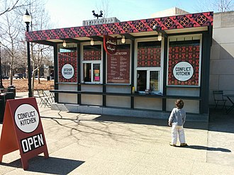 Conflict Kitchen - The Schenley Plaza location, decorated for an Afghan menu