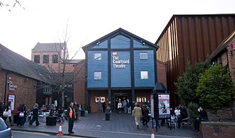 The Other Place (theatre) - Site of the 1990 The Other Place (blue building) temporarily acted as the entrance to the Courtyard Theatre, whose stage, back-stage and auditorium were in the brown corrugated box to the right.