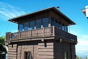 Architects of the National Park Service - Crane Flat Fire Lookout, Yosemite, built in 1931, a two-story structure with a lower storage level and an upper observation level, with an overhanging roof, designed by the National Park Service's Landscape Division to blend with surroundings.
