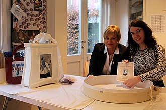 BiArtis - The creator and inventor Elizabeth Suzana Kozina, on the left, with one of her bags.
