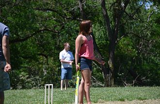 Springbank Island - A batsman watching her shot drop in the lake in the mixed division final at Canberra Beach Cricket 2013