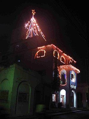 Culture of Cuba - Christmas decorations on a religious house in Santiago de Cuba.