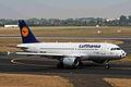 D-AILT A319-114 Lufthansa (football nose) DUS 30JUL06 (5800757392).jpg
