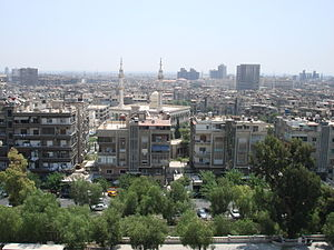 View of Damascus from a bank of Barada river.