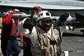 Defense.gov News Photo 110729-N-BT887-039 - U.S. Navy aviation ordnancemen transfer ordnance on the flight deck of the aircraft carrier USS John C. Stennis CVN 74 during preparations for.jpg