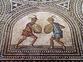 Detail of Gladiator mosaic, two Eques fighting equipped with lance, sword and the traditional small round shield, Römerhalle, Bad Kreuznach, Germany (8197211680).jpg