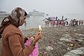Devotee Offering Lighted Diya To Ganga - Makar Sankranti Observance - Kolkata 2018-01-14 6662.JPG