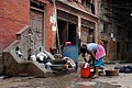 Doing laundry in a street in Nepal (16486685317).jpg