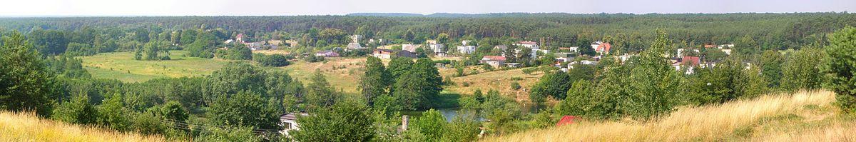 Polski: Osiedle Opławiec - rozproszona zabudowa w dolinie Brdy, na peryferiach miasta
