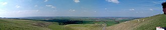 Vale of White Horse - A panoramic view into the Vale; the White Horse is on the right and Dragon Hill centre right