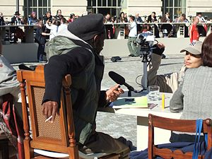 Dropping knowledge - Participant at the Table of Free Voices, answering a question into his camera and microphone