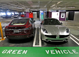 Plug-in electric vehicle - Tesla Model S electric car (left) and Fisker Karma plug-in hybrid (right) at the parking spots reserved for green cars at San Francisco International Airport.