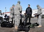 Ed Graff, the superintendent of schools for the Anchorage School District, receives an overview about the Army's explosive ordnance disposal capabilities, as 130425-A-ZX807-007.jpg