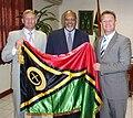Edward Natapei CENTER presenting a ceremonial flag to foreign diplomats.jpg