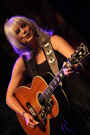 English: Emmylou Harris playing at the 2011 Gr...