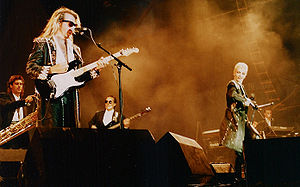Annie Lennox - Lennox (far right) and David A. Stewart (left) performing as Eurythmics in 1987.