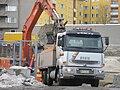 Excavator loading sand onto a truck in Jyväskylä.jpg