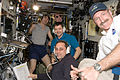 Expedition 30 crew in the Zvezda Module after successful docking of Progress M-14M.jpg