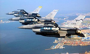 120th Airlift Wing - A three-ship formation of Air National Guard F-16s fly over Kunsan City, South Korea.