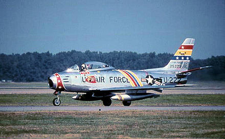 North American F-86F-35-NA Sabre Serial 52-5222 of the 72d Fighter-Bomber Squadron. The aircraft has been restored and is painted in the 21st FBW Wing Commander's motif, with blue, yellow and red striping. It is presently in private hands as civil registration N86FS. - George Air Force Base