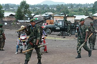 Government troops near Goma during the M23 rebellion in May 2013 FARDC and MONUSCO reinforce their presence in and around Goma following a second day (21 May 2013) of clashes between M23 and National troops. (8782972992).jpg