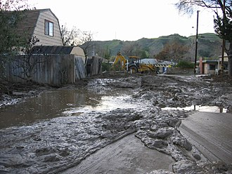 Casitas Springs, California - Mud and water from winter storms that damaged property and roads in Casitas Springs. FEMA photo taken on 01-15-2005.
