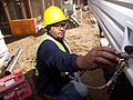 FEMA - 33779 - FEMA contractor installs water service for a mobile home in California.jpg