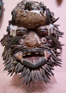 A Wee face mask designed to look like a leopard. On display at the Indianapolis Museum of Art