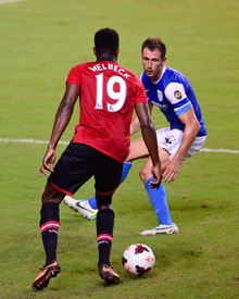Fernando Recio, player of Kitchee SC, in action against Danny Welbeck.png