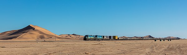 Cargo train pulled by a South African Class 33-400 locomotive in the route Swakopmund-Walvis Bay, Namibia.