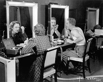 Eddie Albert and Grace Brandt apply makeup for the first television broadcast of a play (November 1936).