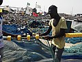 Fisherman mending a fishing net.jpg