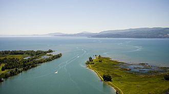 Bigfork, Montana - The Flathead River emptying into the north end of Flathead Lake at Bigfork, Montana, with the Salish Mountains in the distance.