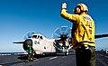 Flickr - Official U.S. Navy Imagery - A Sailor directs a C-2A Greyhound on the flight deck..jpg