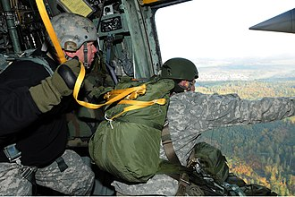 United States Army Jumpmaster School - An instructor from the USASOC Jumpmaster School's MTT evaluates a student conducting PWAC as he checks for obstacles and spots the drop zone
