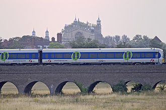 Slough–Windsor & Eton line - A 2-car Class 165 DMU, on the brick viaduct carrying the GWR line into Windsor (looking east towards Eton College).