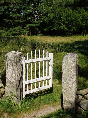 A small but elegant gate to a meadow path.