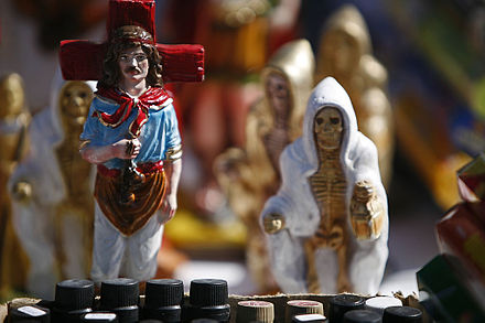 Gauchito Gil (left) San La Muerte (right) two popular Saints on display in Argentina Gauchito Gil and San La Muerte.jpg