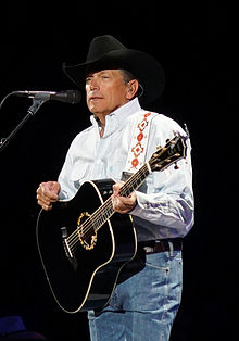 A photo of George Strait holding a guitar