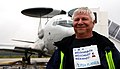 Gerrit Vos, a Dutch aircraft maintenance specialist with the NATO E-3A Component, poses for a photo in front of an E-3 Sentry aircraft at NATO Air Base Geilenkirchen, Germany, Sept 130918-F-WP626-710.jpg