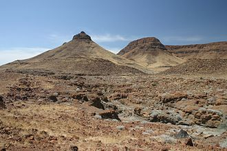 Pediplain - View of a scarpment and pediment in Namibia. The somewhat flat area in the foreground is an incipient pediplain.